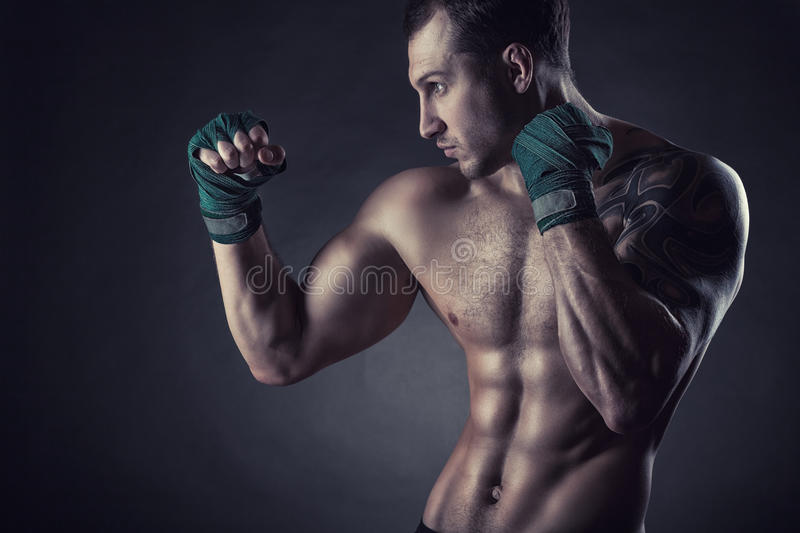 Boxing man. Ready to fight. Boxer with strong hands and clenched fists on a black background royalty free stock photos