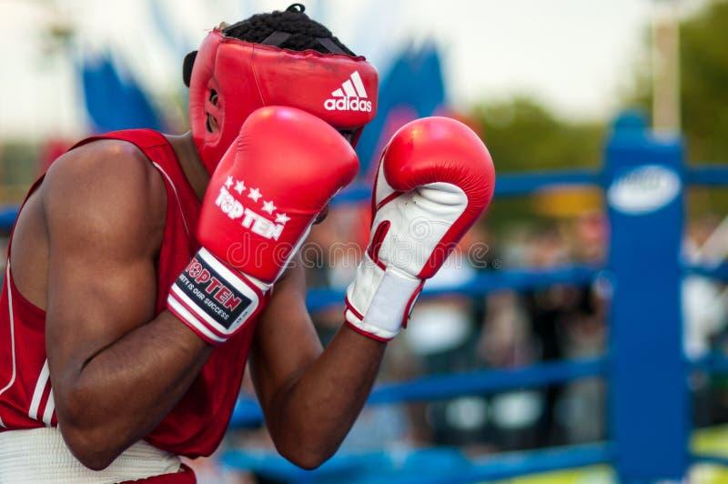 A boxing match Osleys Iglesias, Cuba and Salah Mutselkhanov, Russia. Victory Osleys Iglesias stock photos