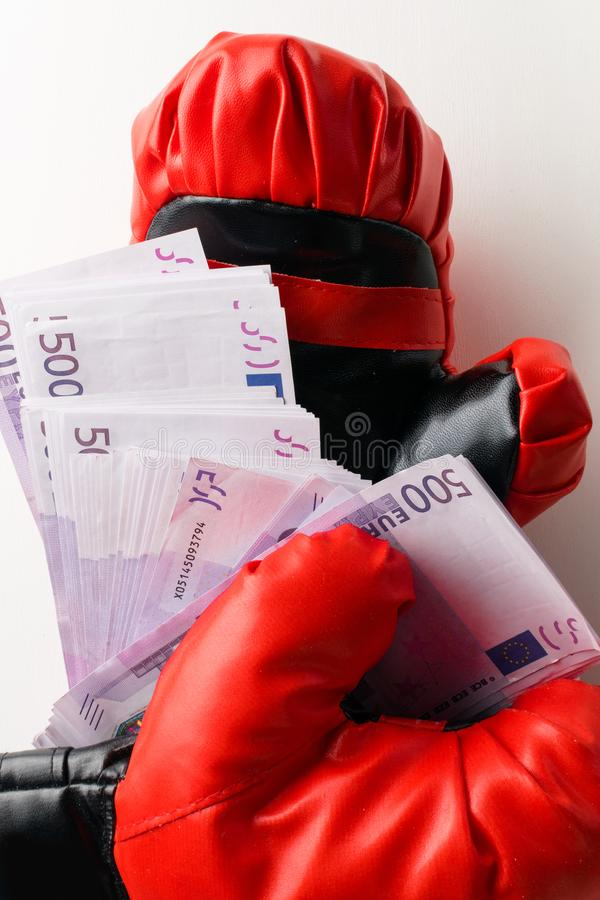 Boxing for money, boxing glove with cash stock photos