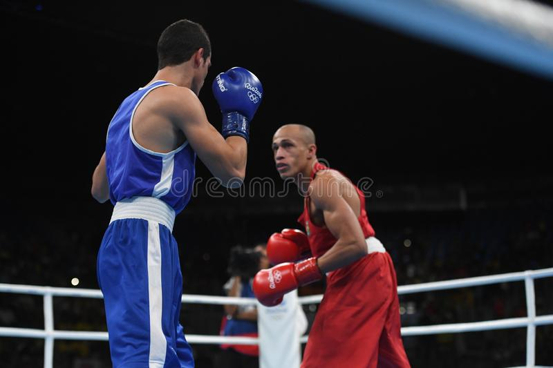 Boxing olympic sport. Boxing match between Brazil and Russia at the 2016 Olympic Games in Rio de Janeiro, photos with low speed effect stock photography