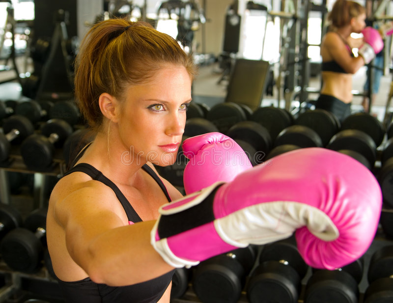 Boxing With Pink Gloves 2. Beautiful boxing girl wearing pink gloves stock photography