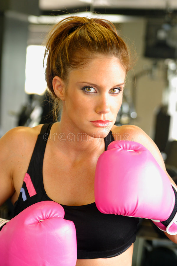 Boxing With Pink Gloves 3. Beautiful boxing girl wearing pink gloves royalty free stock photography