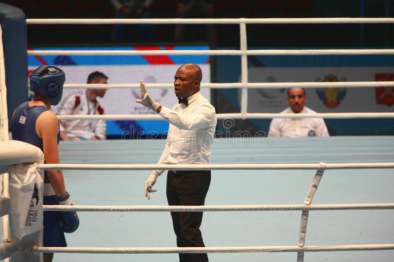 Boxing referee believes knockdown. St. Petersburg, Russia, November 21, 2016 AIBA Youth World Boxing Championships men stock images