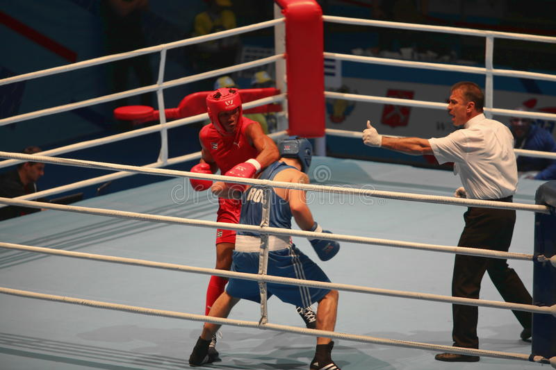 Boxing referee makes admonition to boxer. St. Petersburg, Russia, November 23, 2016 Youth World Boxing Championship men, Boxing referee makes admonition to boxer stock image