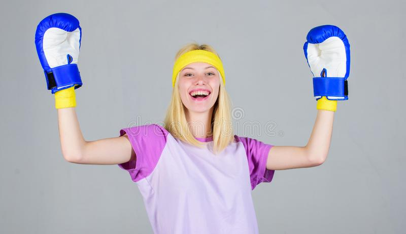 Boxing sport concept. Cardio boxing exercises to lose weight. Femininity and strength balance. Woman boxing gloves enjoy. Workout. Girl learn how defend herself royalty free stock image