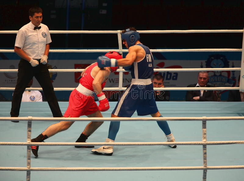 Boxing uppercut strong hit bottom. St. Petersburg, Russia, November 21, 2016 AIBA Youth World Boxing Championship�s men heavy 81 kg. Boxing match between stock photo