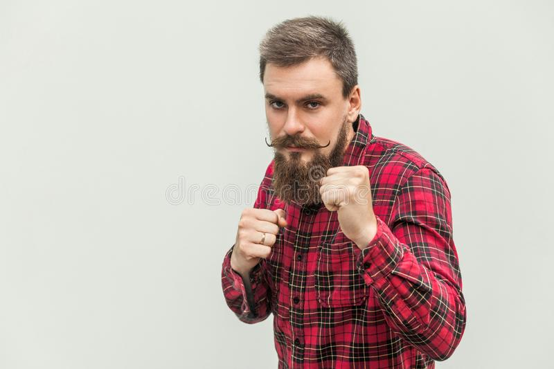 Boxing. Young adult businessman, ready for fight stock photography