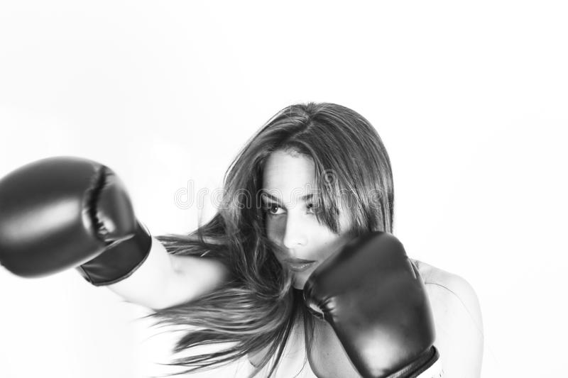 Boxing young girl. In motion royalty free stock photo