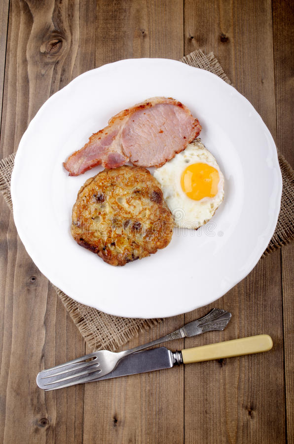 Boxty with fried egg and bacon stock image