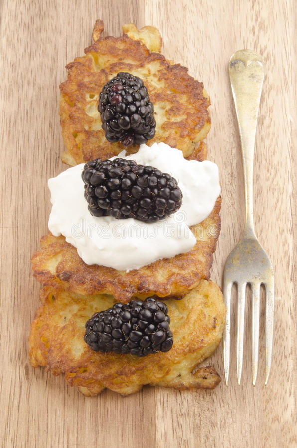 Boxty, irish pancake with blackberries royalty free stock photos