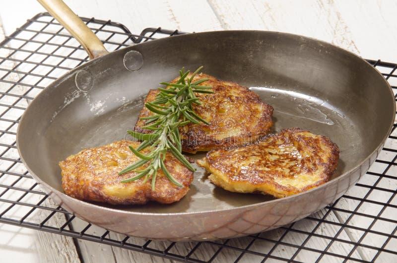 Boxty irish pancake in a pan royalty free stock photos