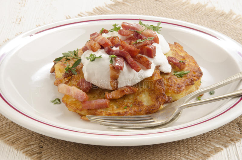 Boxty, irish pancake with sour cream royalty free stock images