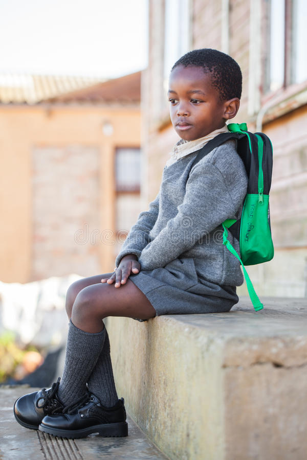 Boy. The little boy is waiting for the bus to pick him up for school royalty free stock photos