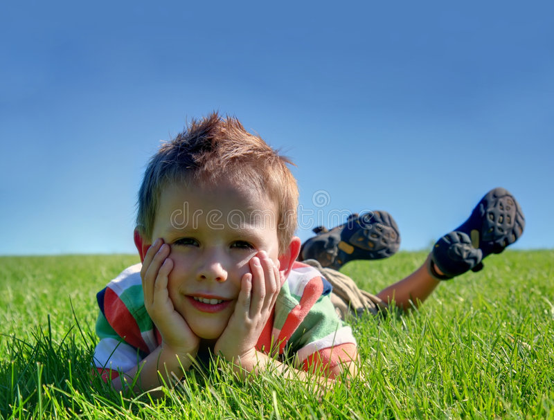Download A boy stock image. Image of grass, green, blue, resting - 6147459