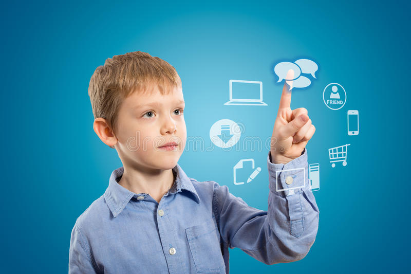 Boy accessing futuristic entertainment applications. From the cloud computing interface stock photos