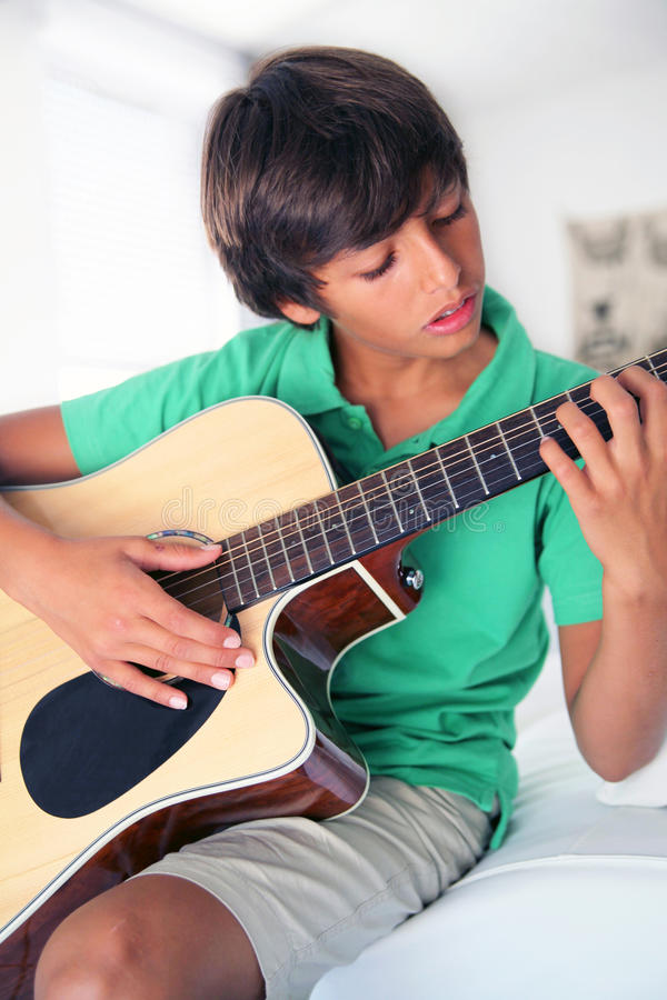 Boy with acoustic guitar royalty free stock image