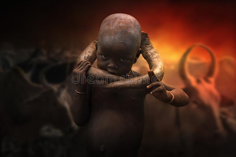 Boy from the African tribe Mursi, Ethiopia royalty free stock photo