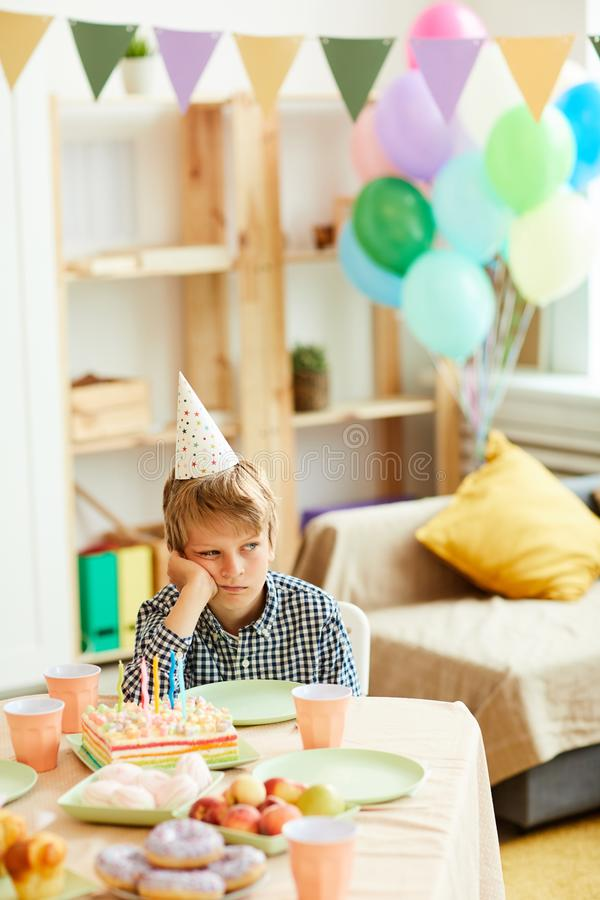Boy Alone at Birthday Party stock photography