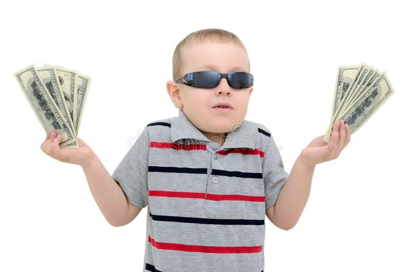 Boy in amazement holding money on white background royalty free stock image