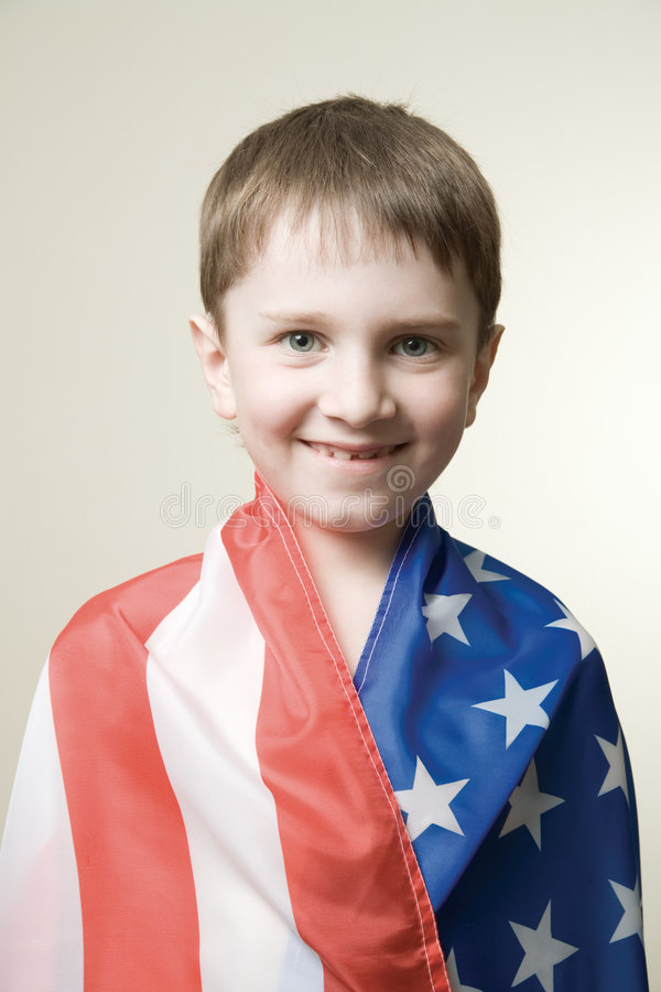 Boy in american flag stock photo