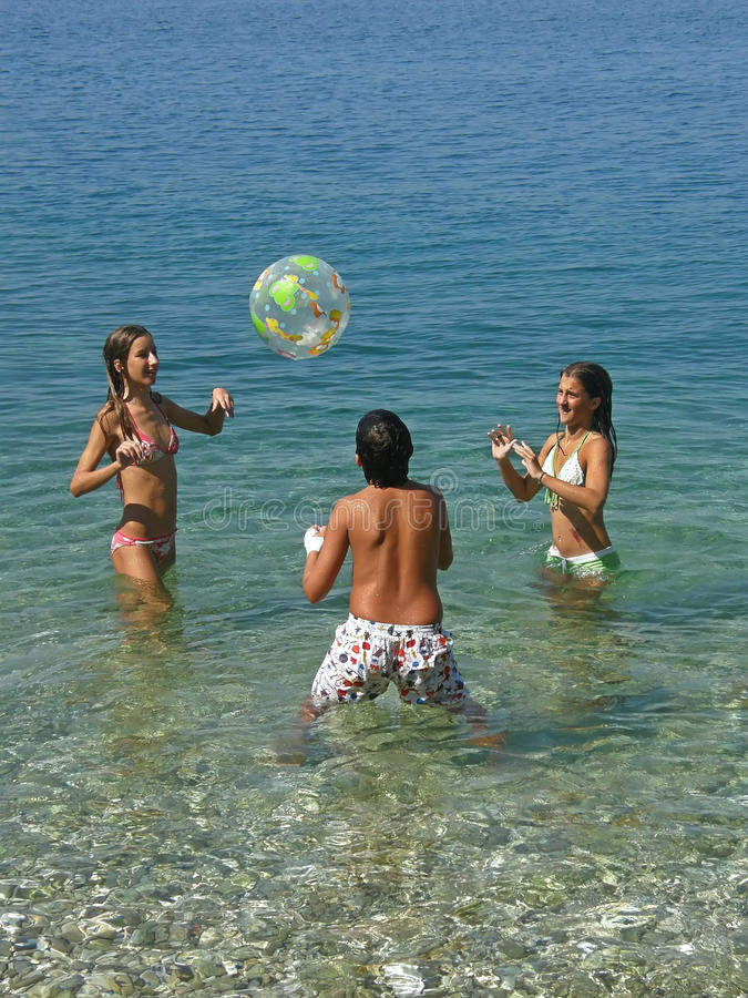 Free Boy And Girls Playing With Ball On Sea Stock Image - 10802481