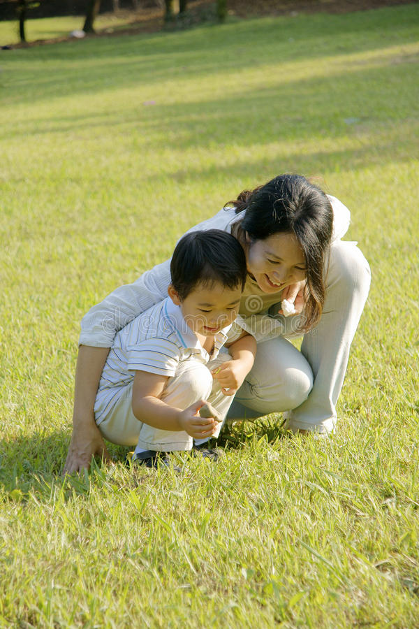 Free Boy And Mother Playing On Lawn Stock Image - 11265761