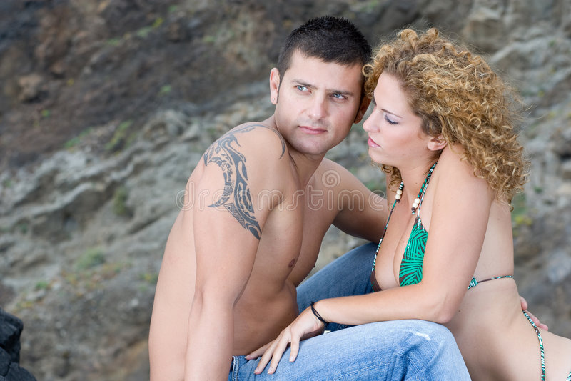 Boy ang girl on the beach royalty free stock image