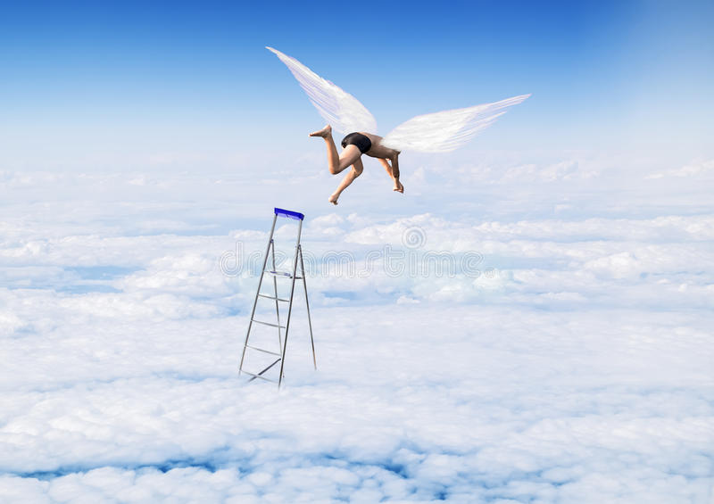 Boy with Angel Wings flying, jumping from the stairs in the sky royalty free stock image