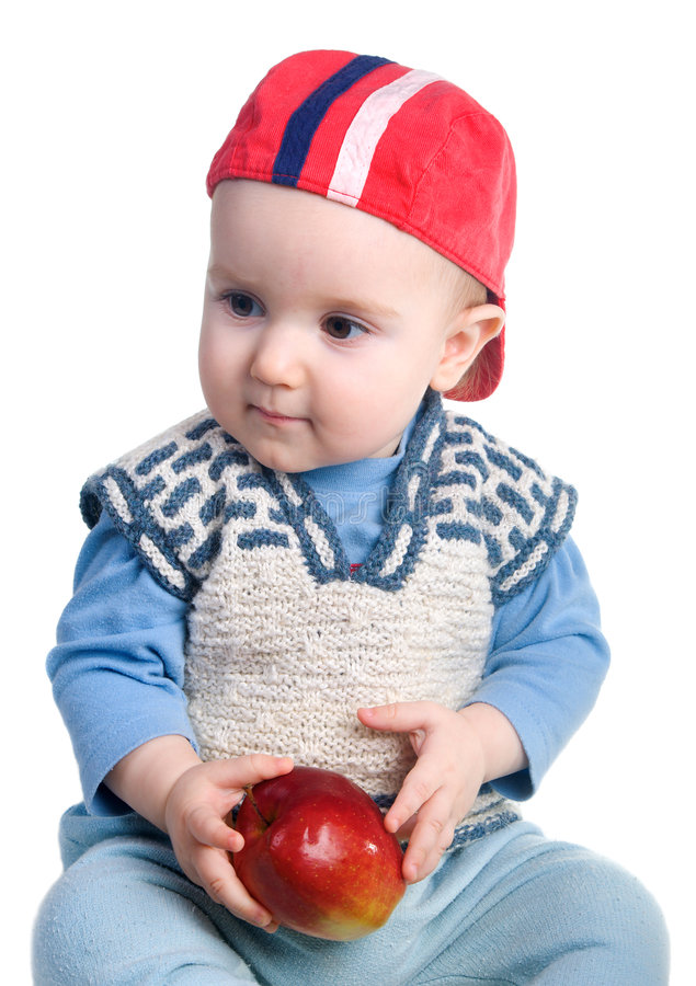 Boy and apple stock photo