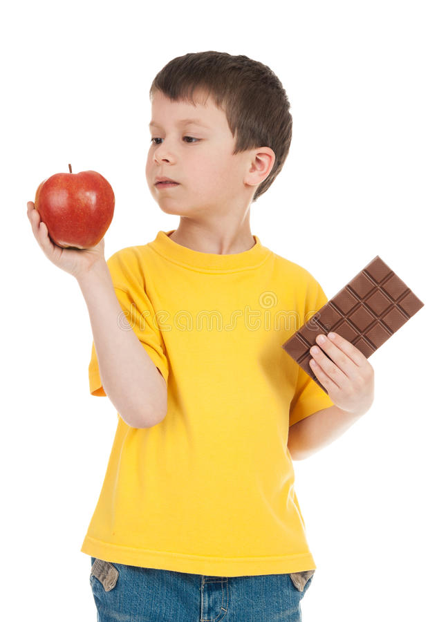 Boy with apple and chocolate royalty free stock images