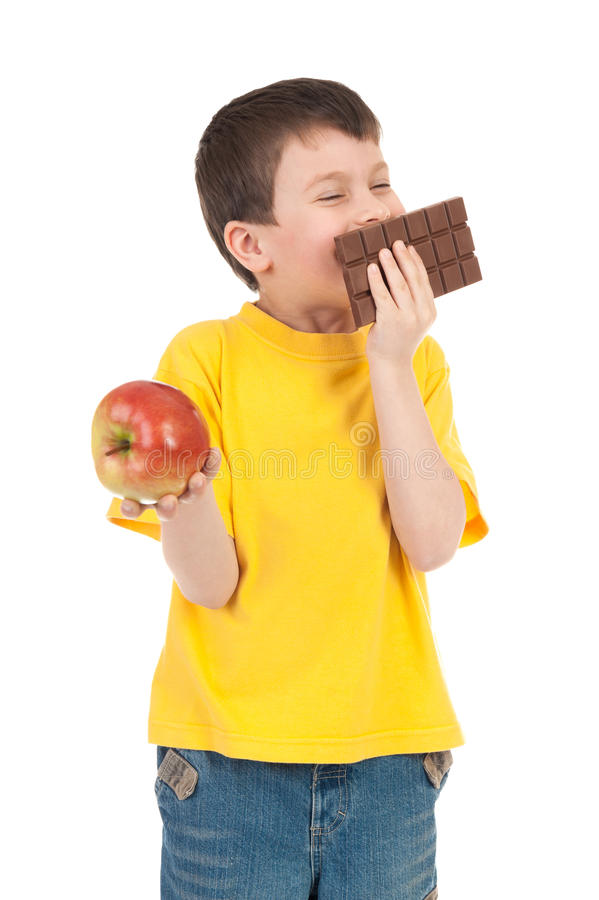 Boy with apple and chocolate stock photos