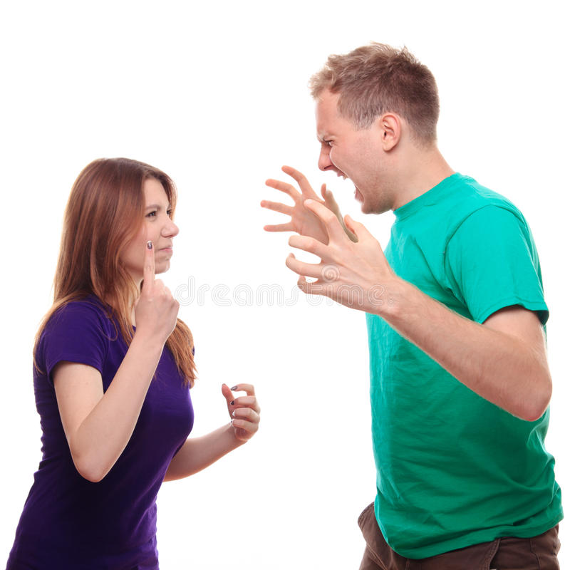 Boy arguing with his girlfriend. Studio shoot stock images