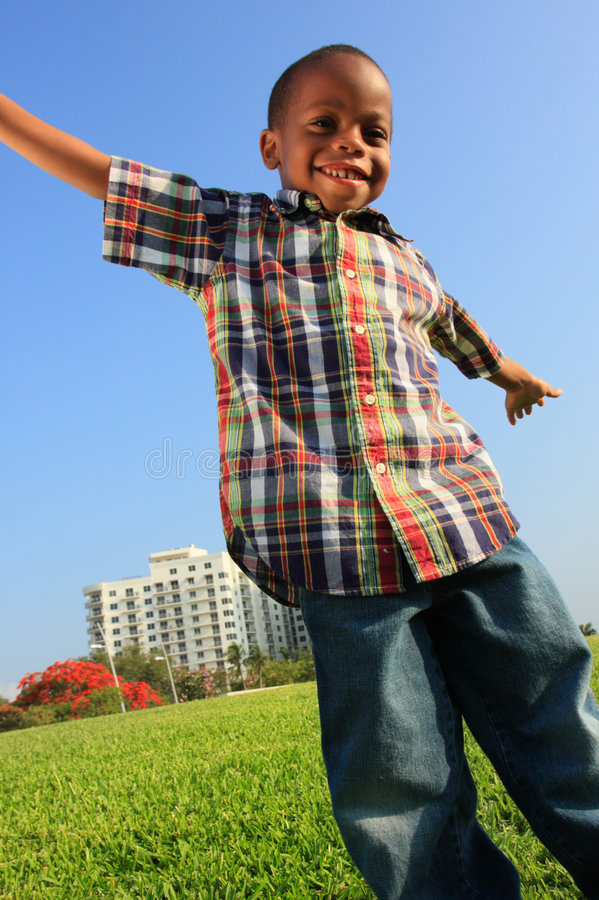 Boy With Arms Extended royalty free stock images
