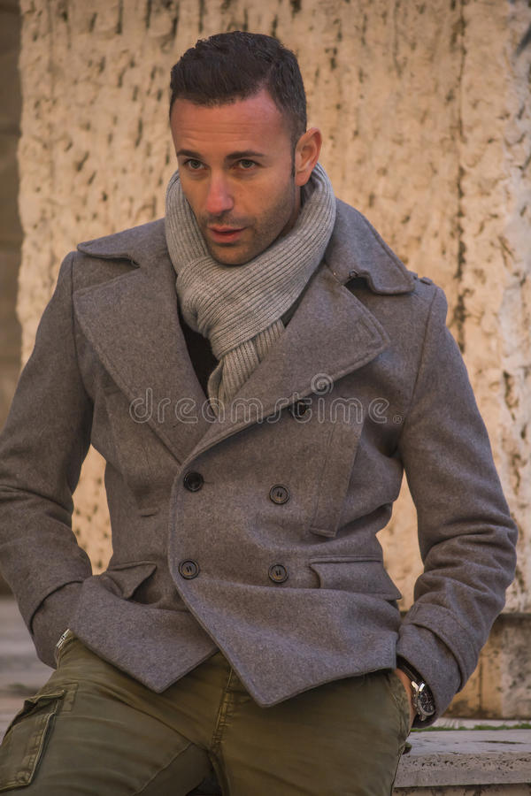 Attractive man with coat stock photography