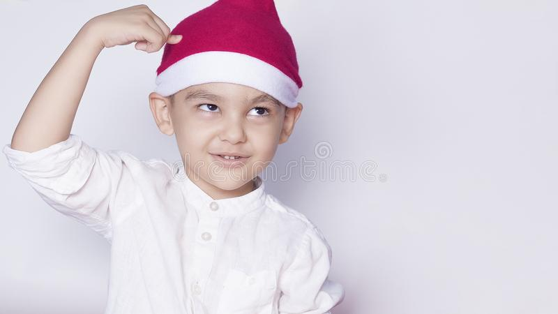 Boy asking are you idiot, are you serious or are you crazy. 6 year boy showing hand gesture. Kid portrait gesturing with fingers stock photo