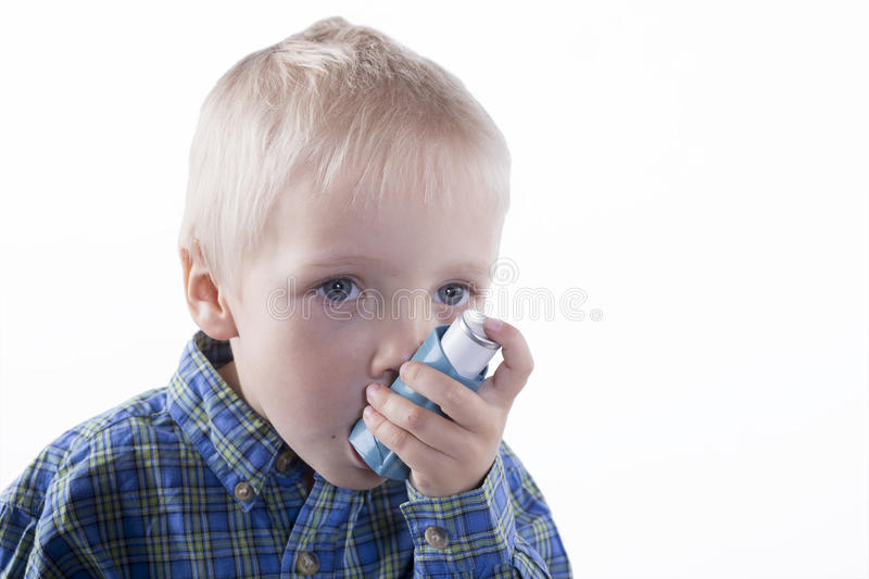 Boy and asthma inhaler royalty free stock photo