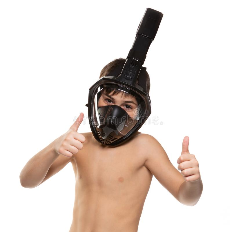 Boy athlete with a full face diving mask on his face, boy shows gestures, lifestyle concept, on a white background royalty free stock photos