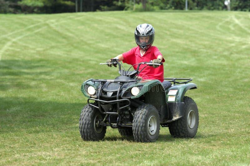 Boy on ATV royalty free stock photo