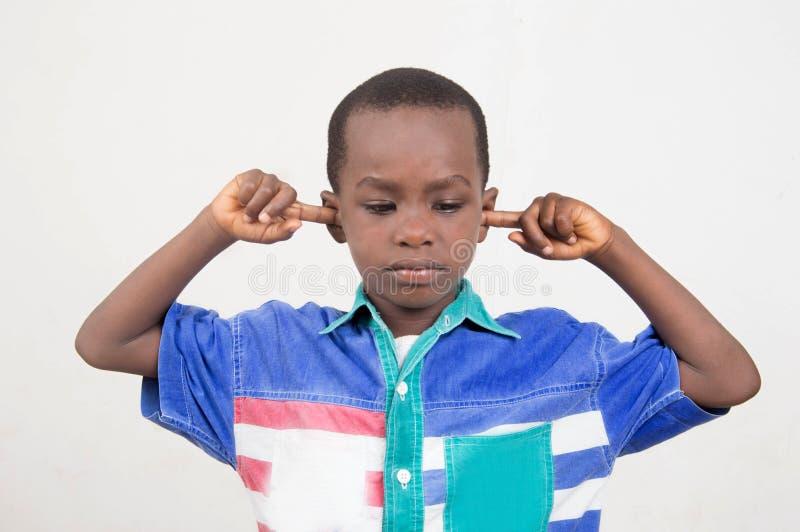 Boy avoiding hear everything stock photos