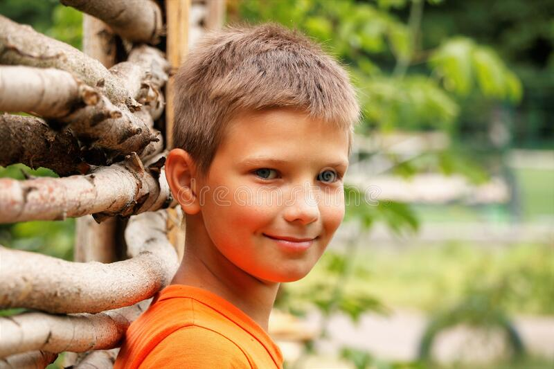 Boy baby stands near fence thinks summer royalty free stock photo