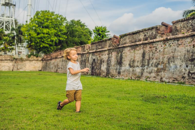 Boy on background of Fort Cornwallis in Georgetown, Penang, is a star fort built by the British East India Company in the late 18t. H century, it is the largest stock image