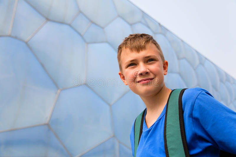 Boy with the backpack in the Olympic Park in Beijing. Boy backpacker traveling in the Olympic Park in Beijing stock image