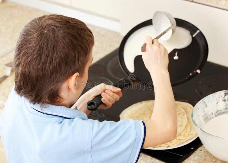 Boy Bakes Pancakes At Home Royalty Free Stock Photography