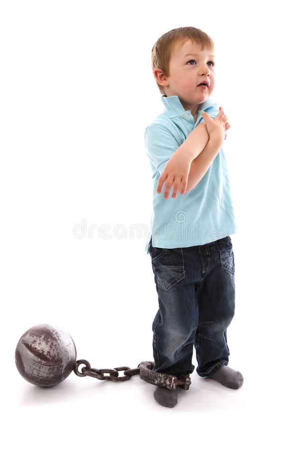 Boy With Ball & Chain royalty free stock photos