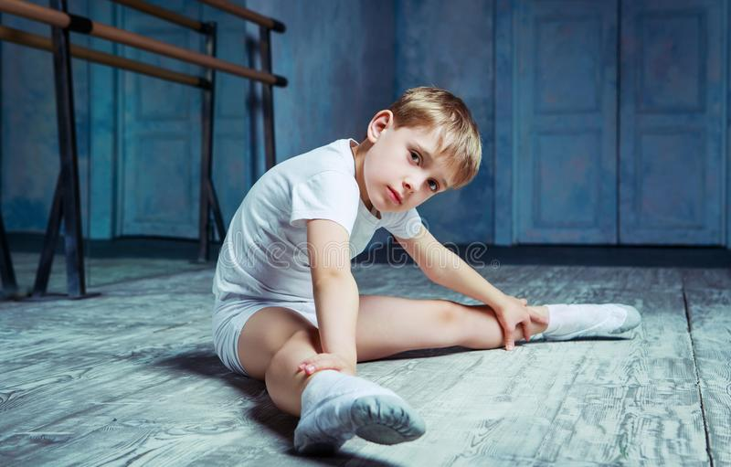 Boy ballet dancer at dance class royalty free stock photo