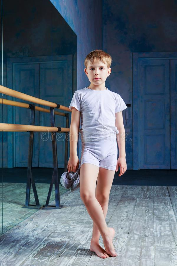 Boy ballet dancer posing at dance class stock images