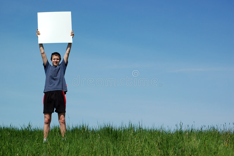 Boy with banner. Happy boy on sky background stock image