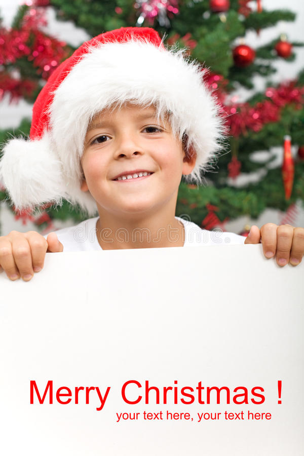 Boy With Banner And Christmas Hat Stock Photos