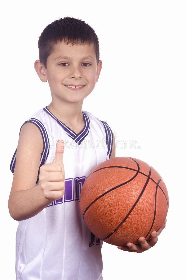 Boy and basketball stock image