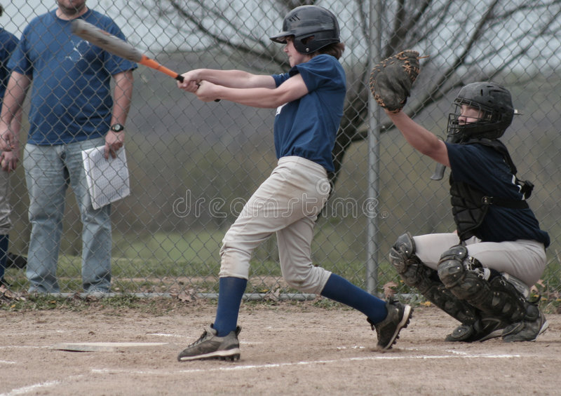 Boy Batter Batting Baseball stock photo